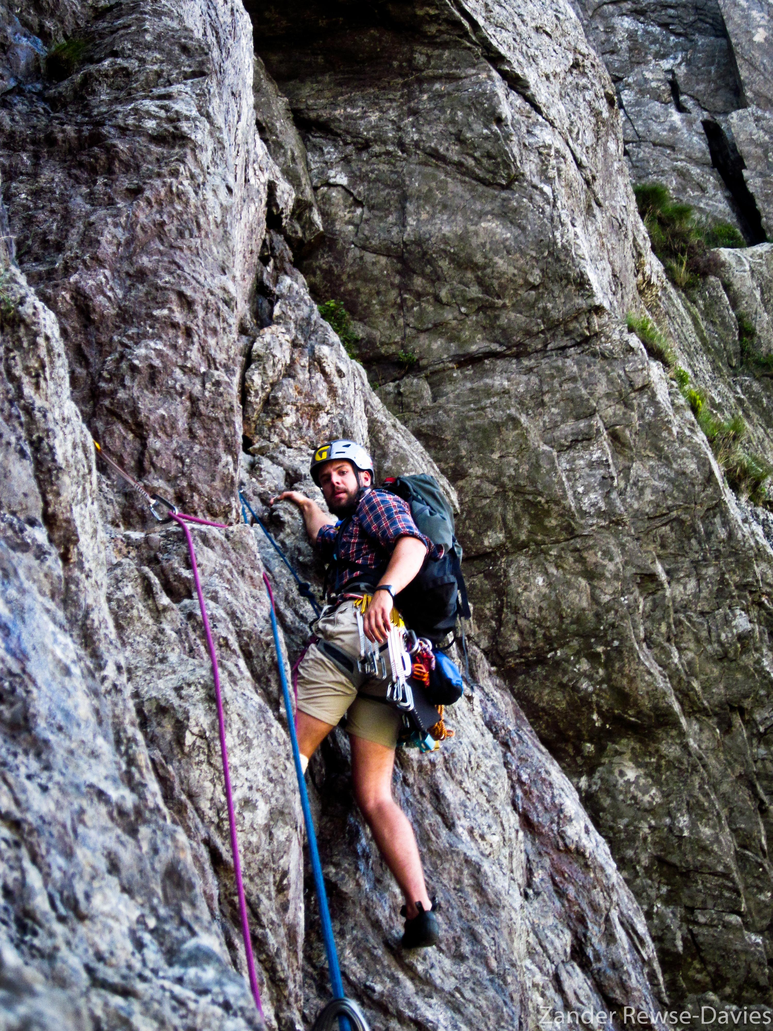 Zander climbing Main Wall in Wales (HS, 4b)