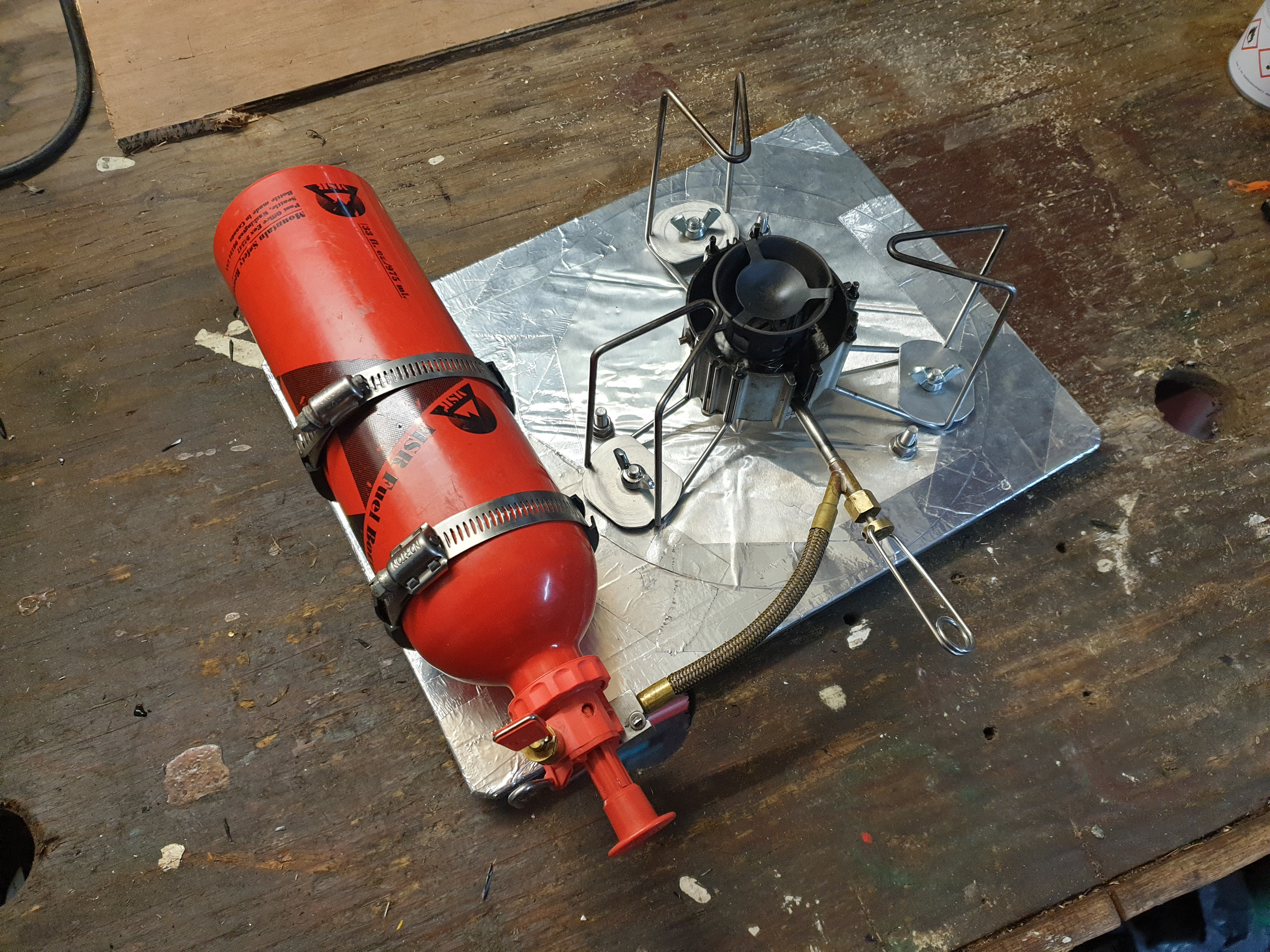 MSR Dragonfly and fuel bottle mounted onto the stove board