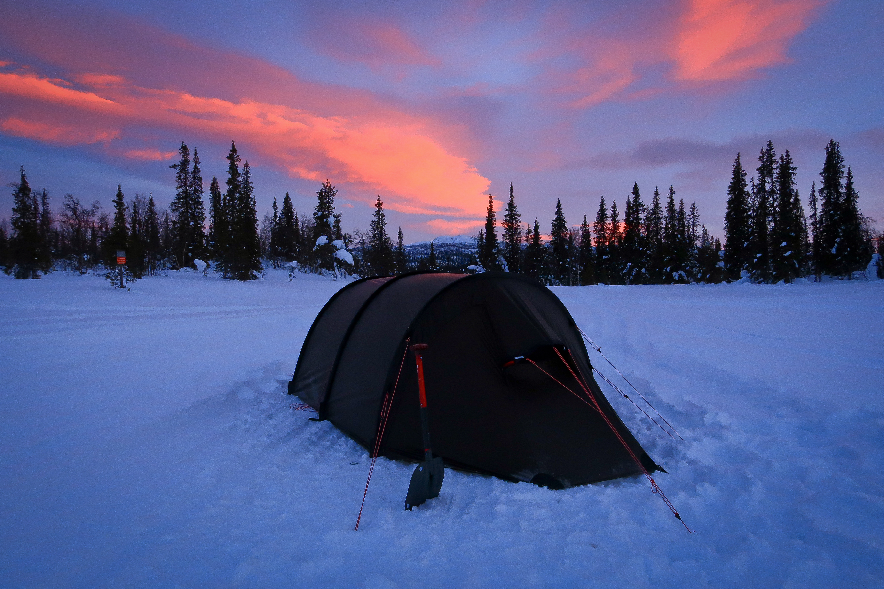Tent pitched on the only hard snow around