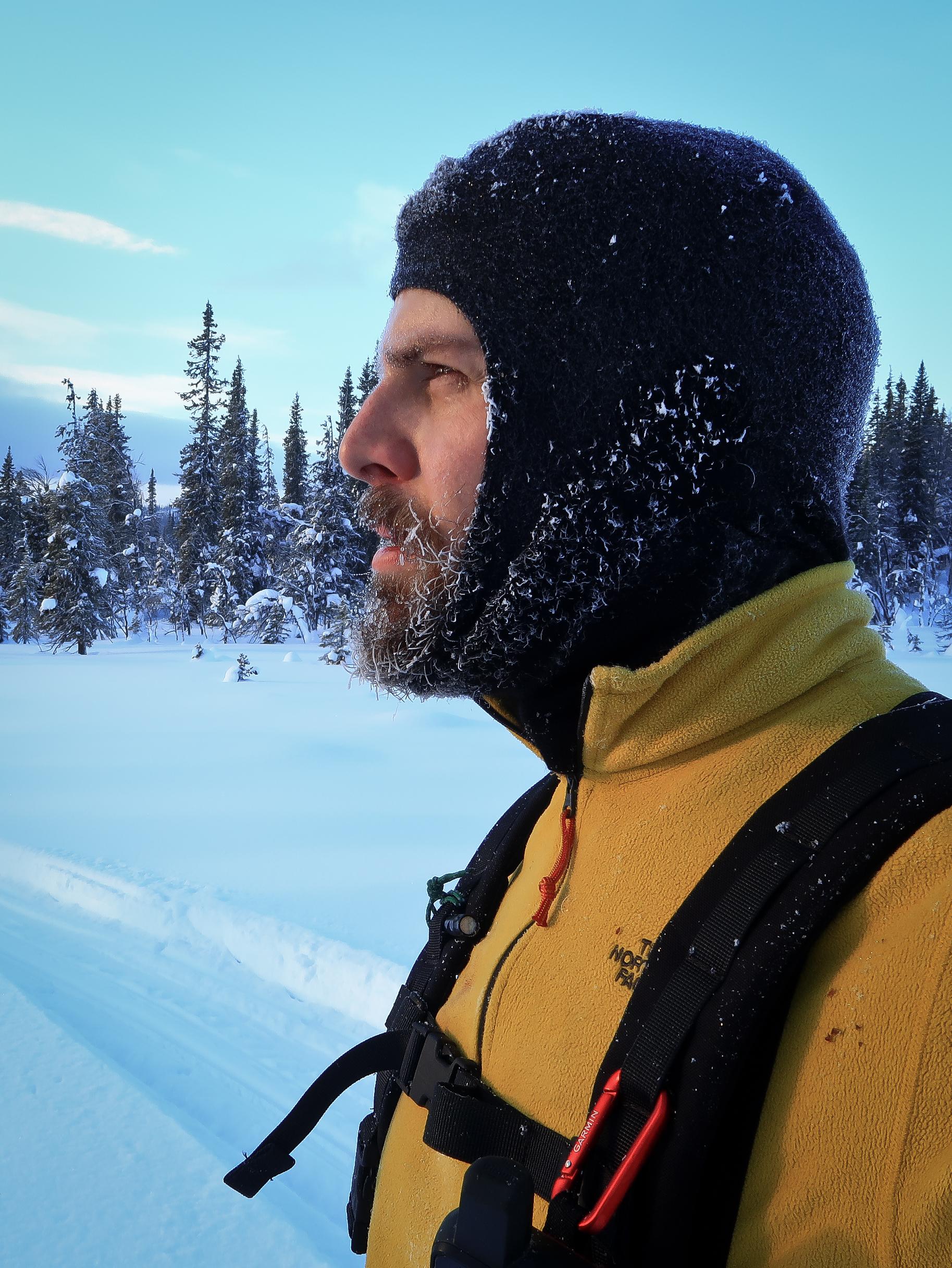 Checking progress while breaking trail through deep snow