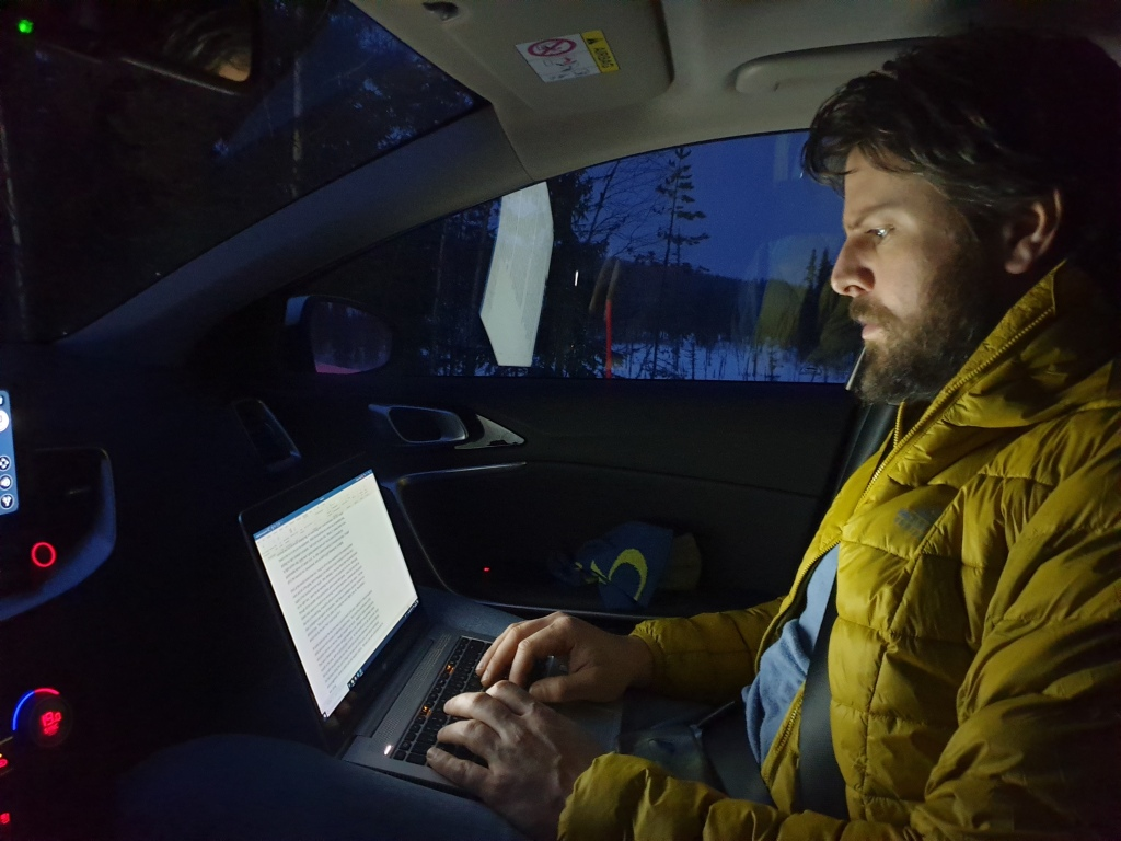 Zander writing the first Part of the Sarek Adventure in the car